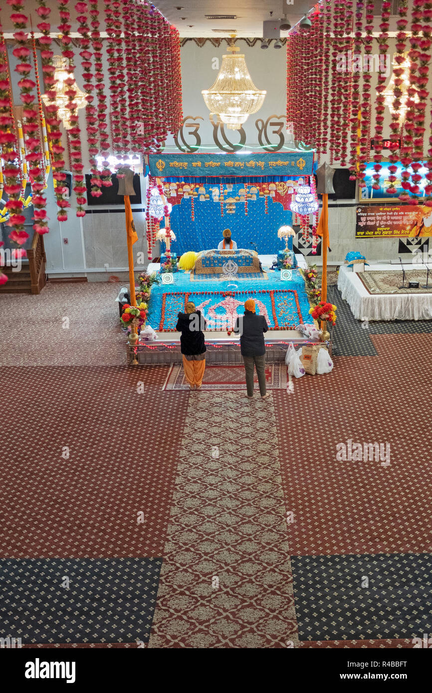 The altar at  Baba Makhan Shah Lobana Sikh temple in Richmond Hill, Queens, New York specially decorated for the birthday of Guru Nanak. - Stock Image