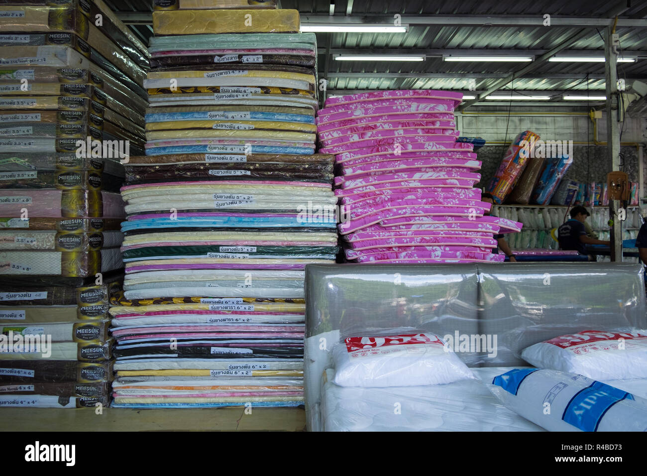 A store bursting with mattresses in Hat Yai, Thailand. - Stock Image