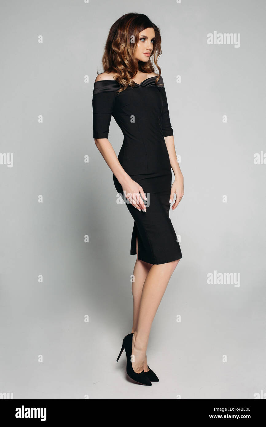 12b9b45c1b07 Elegant slim woman in black classic dress and heels Stock Photo ...