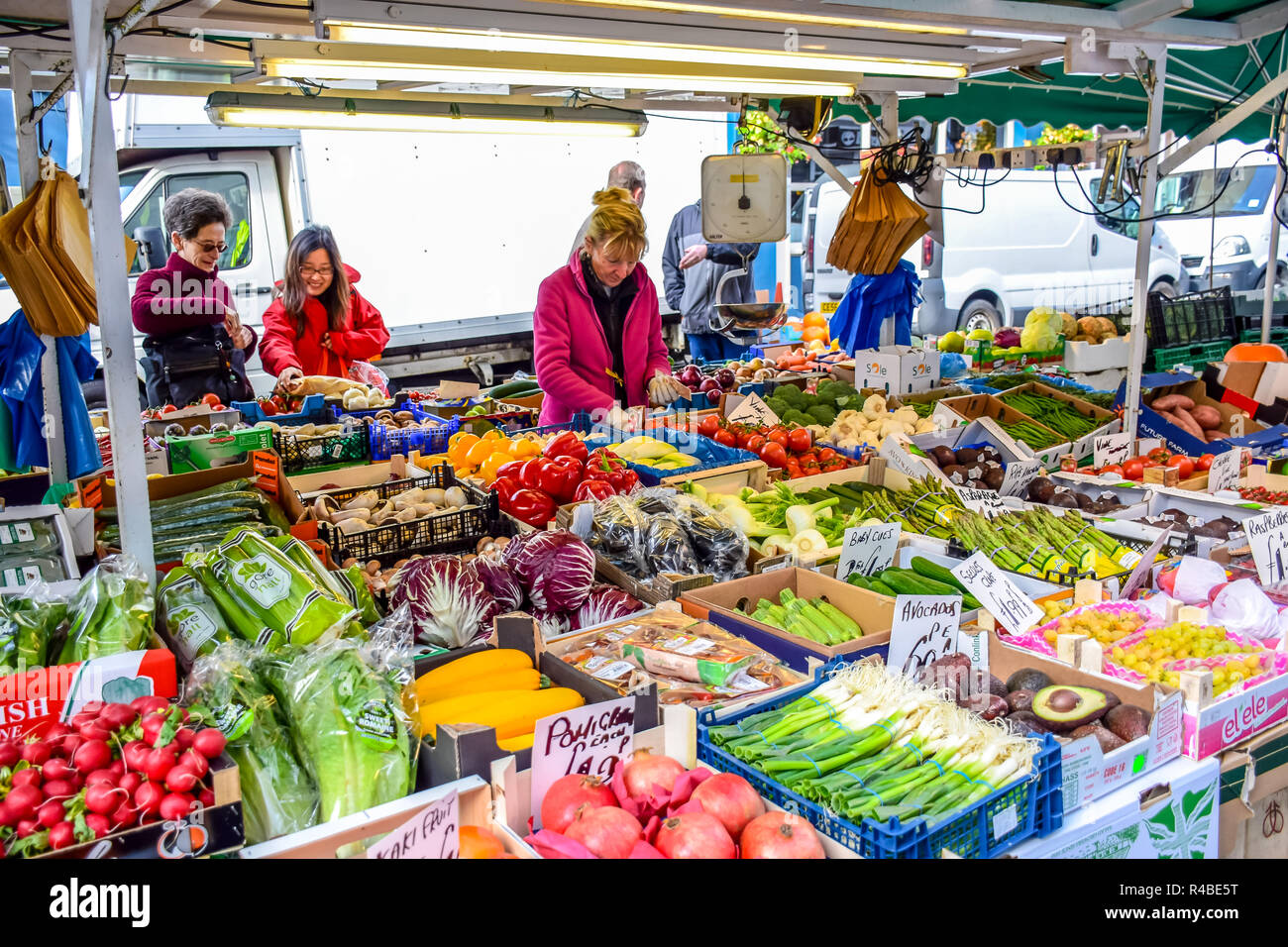 People buying fruits and vegetables at market stall in Portobello Road Market, Notting Hill, London, England, United Kingdom Stock Photo