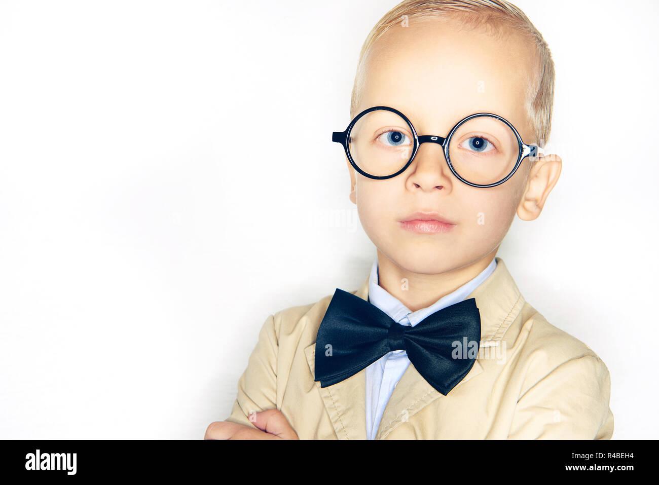 c3ea36fffdc5 Cute little blonde boy dressed like a professor wearing a suit, bowtie and  glasses standing