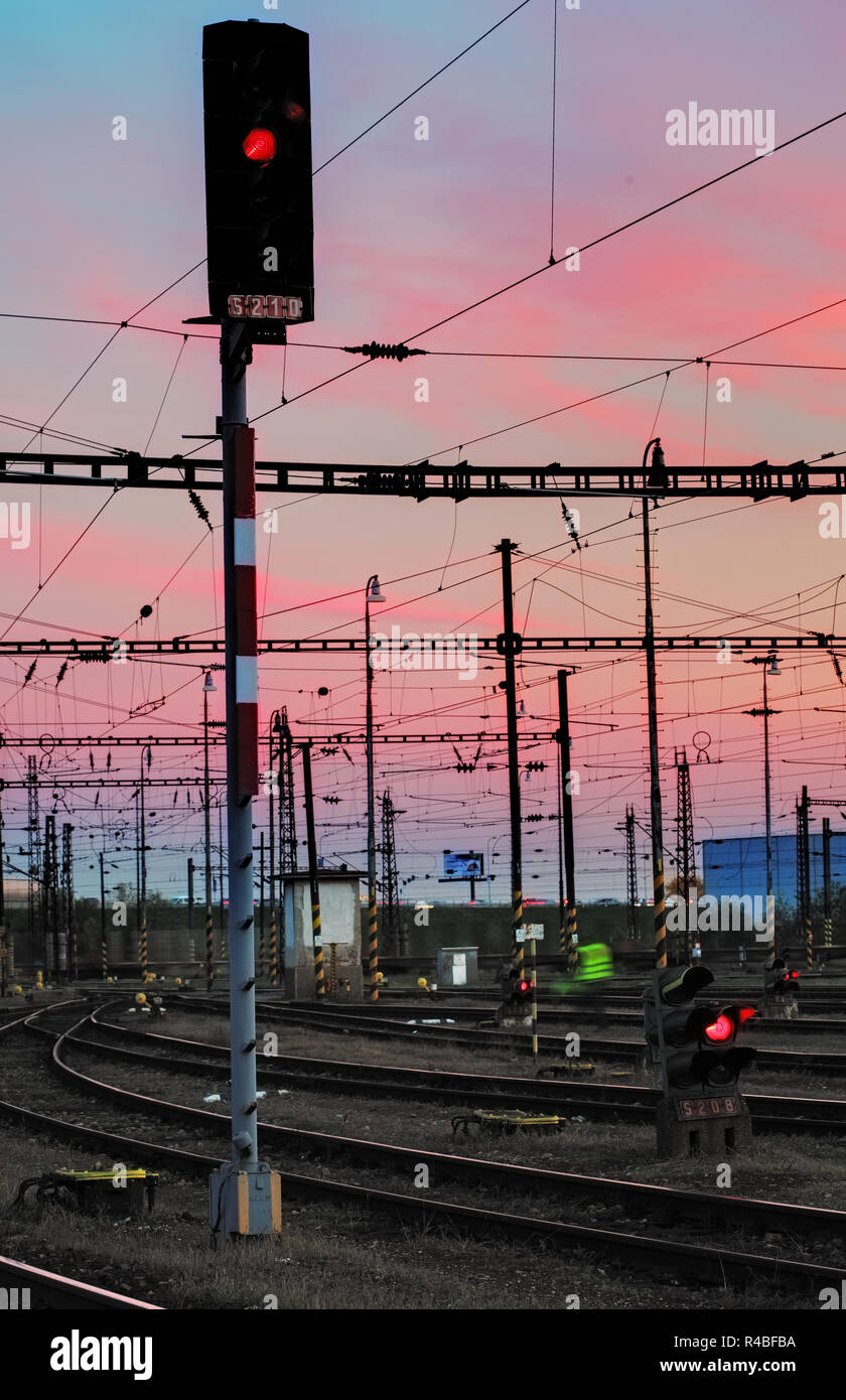 Railway Tracks at a pink  colorful sunset - Stock Image