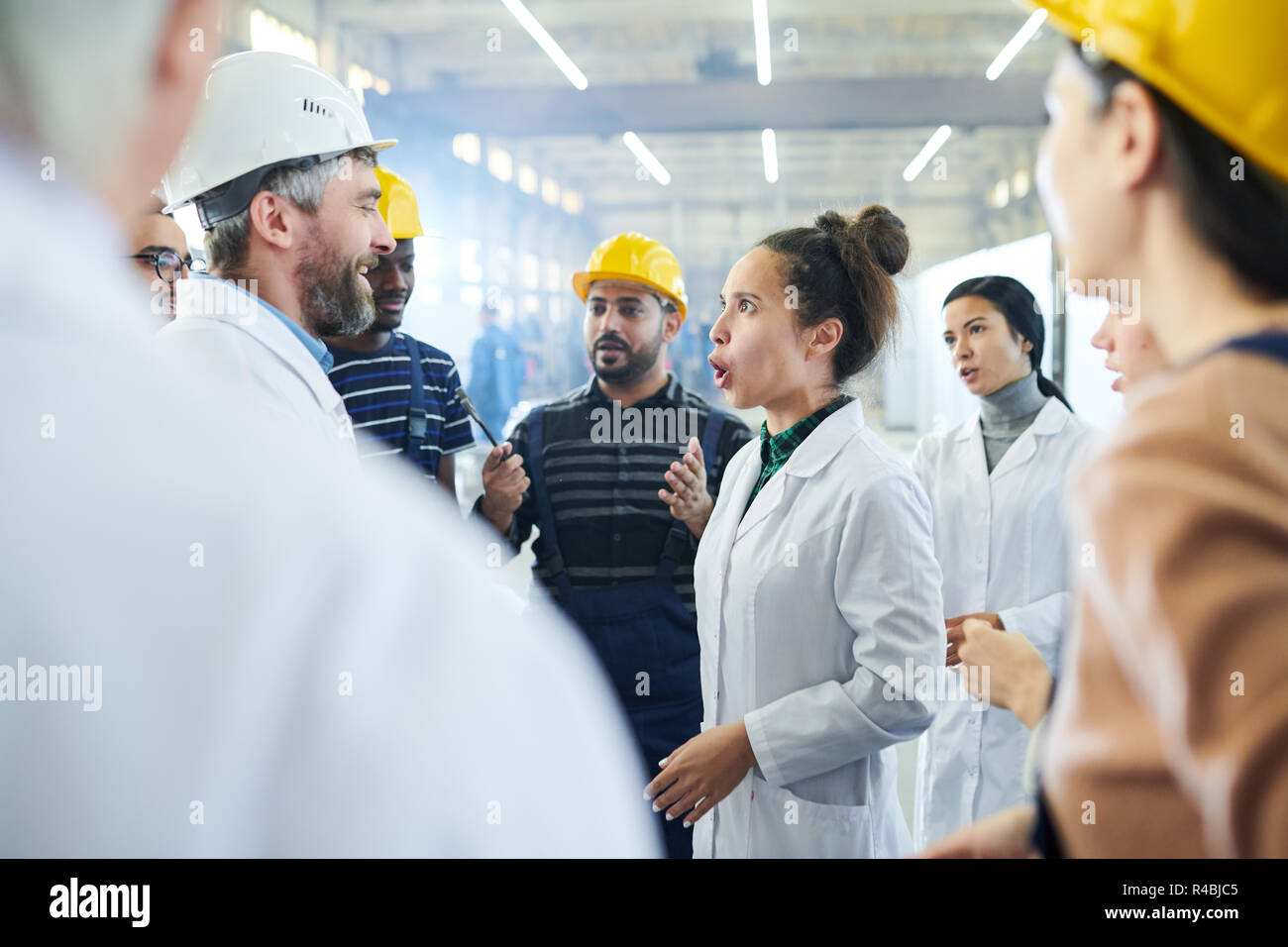 Angry Woman Shouting at Managers - Stock Image