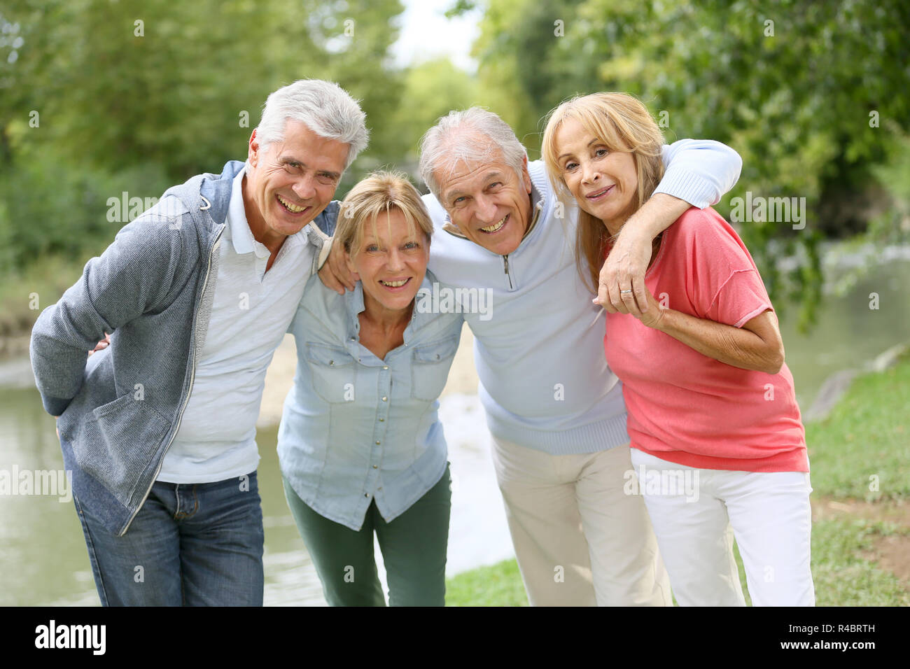 Senior couples having a good time in countryside - Stock Image
