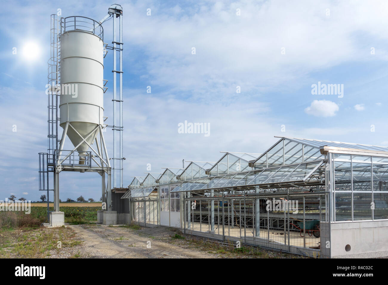 Silo at a sewage sludge drying plant - Stock Image