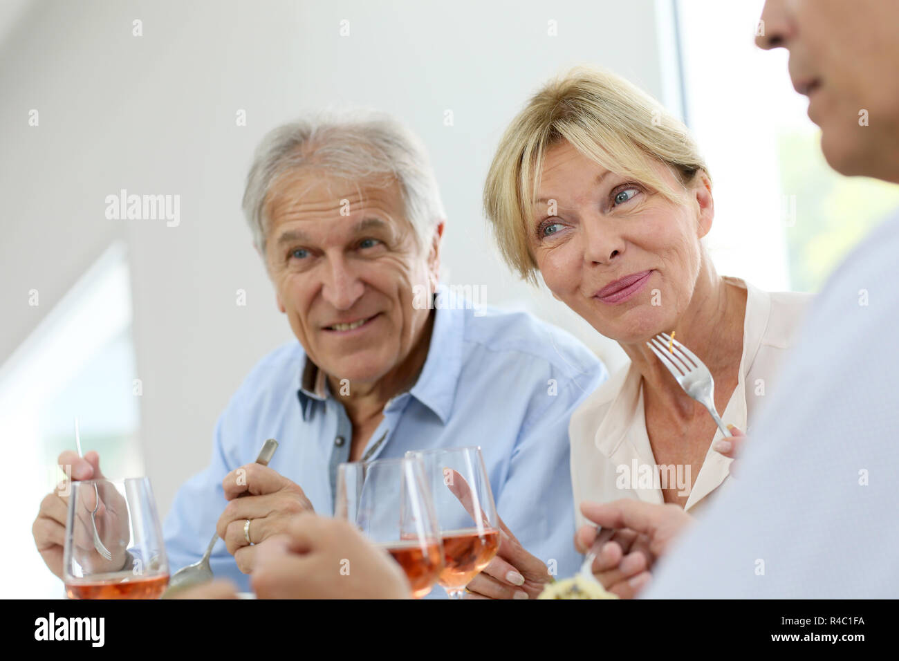 Portrait of senior people at lunch time - Stock Image
