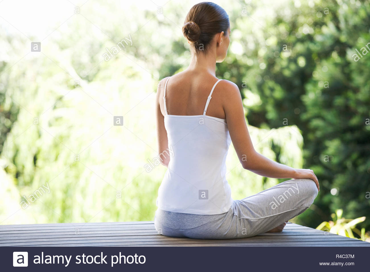 A young woman meditating - Stock Image