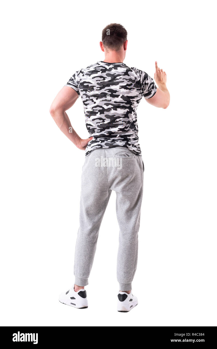 Back View Of Athletic Sporty Man Pointing Finger On Interactive
