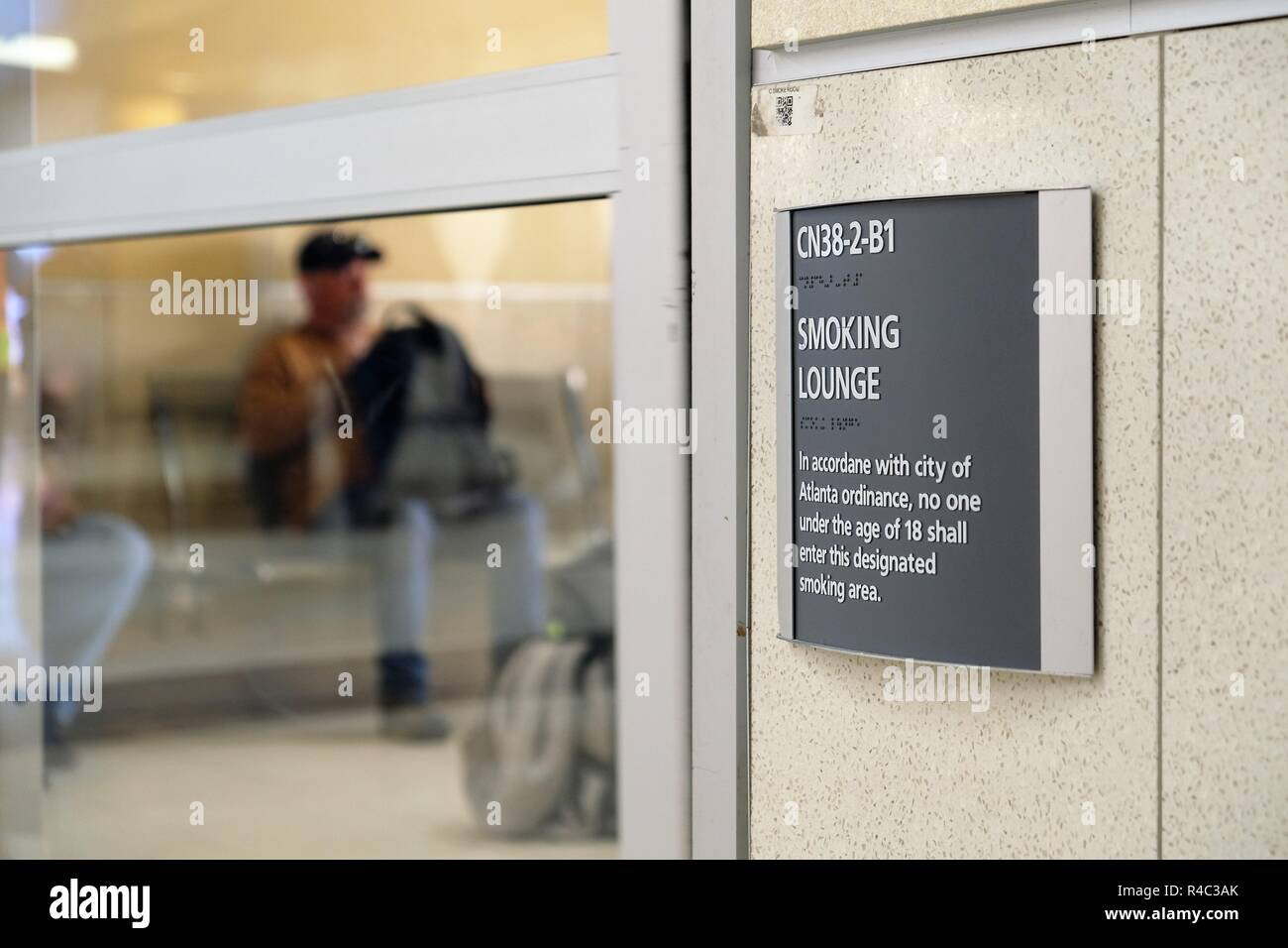 Smoking lounge at Terminal C in Hartsfield-Jackson Atlanta International Airport; Atlanta, Georgia, USA. - Stock Image