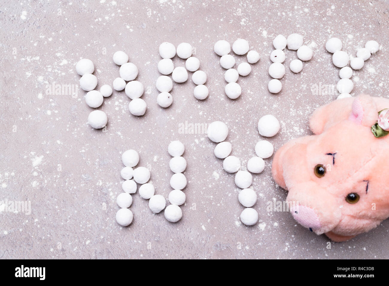 lucky pig with english sweet berry text happy new year english new year greetings snow on background