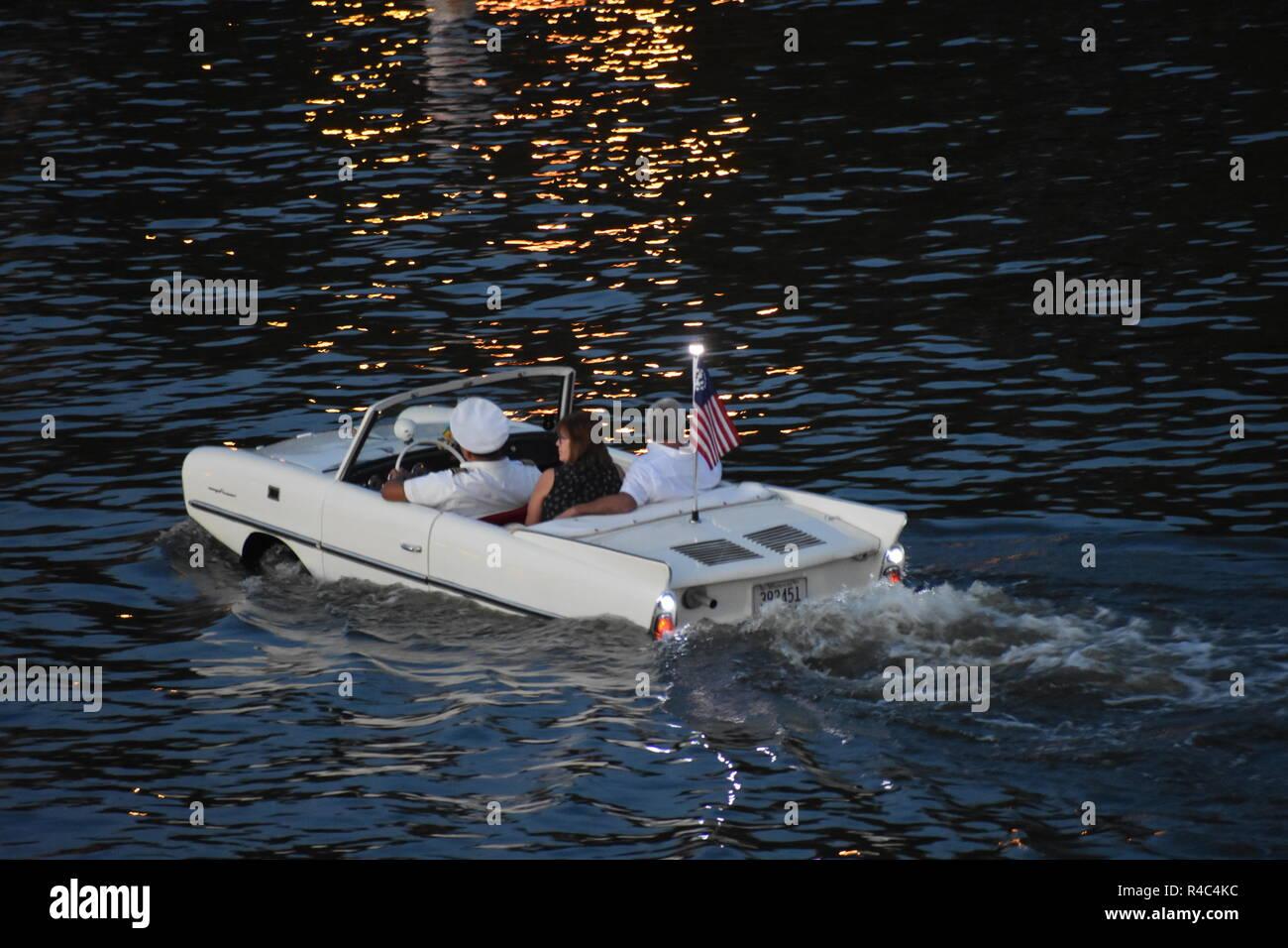 Orlando, Florida.  November 17 , 2018 . Couple enjoying Amphibious vintage white car ride at Lake Buena Vista area . - Stock Image