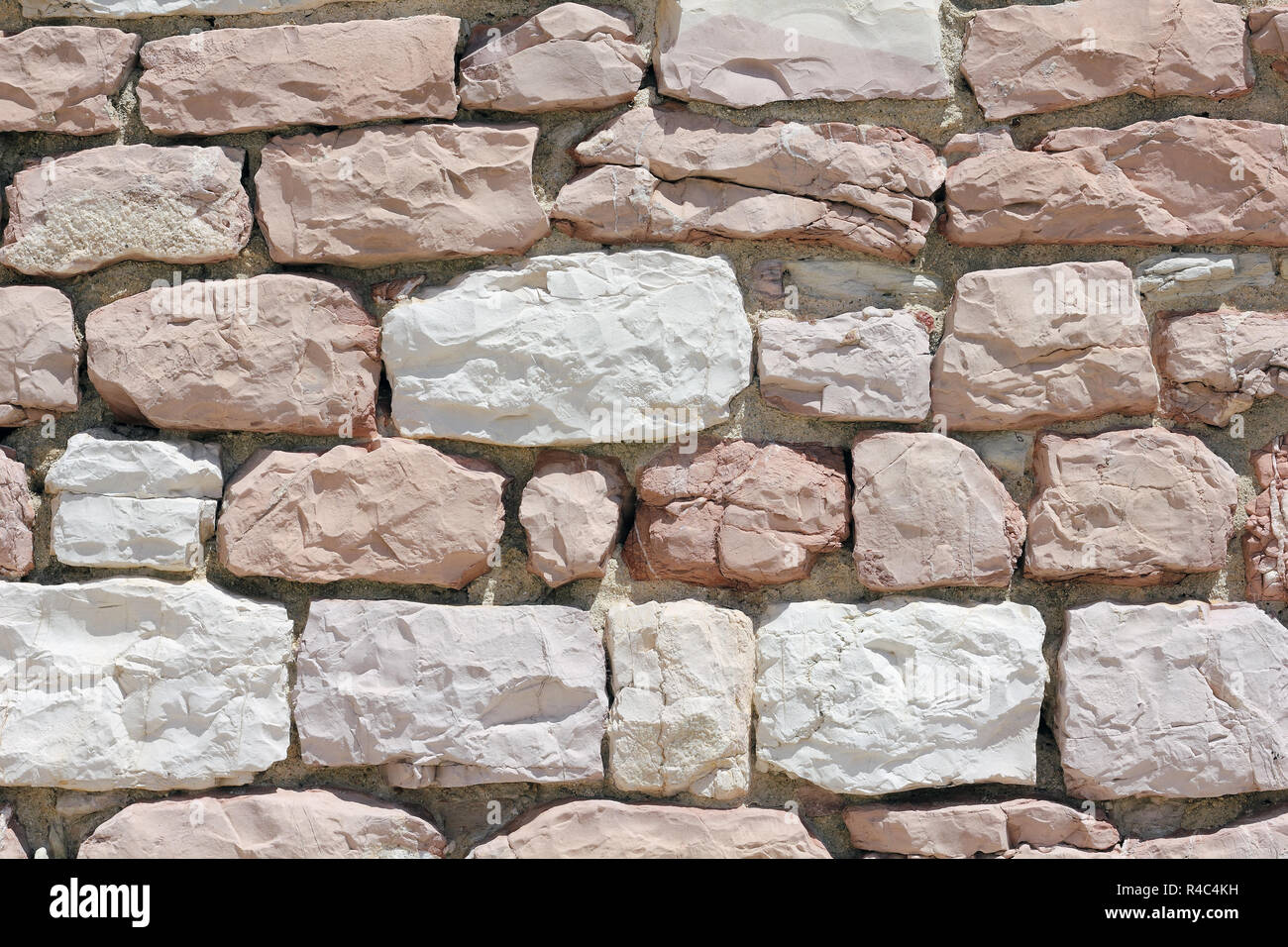Wall made from white and pink limestone - Stock Image
