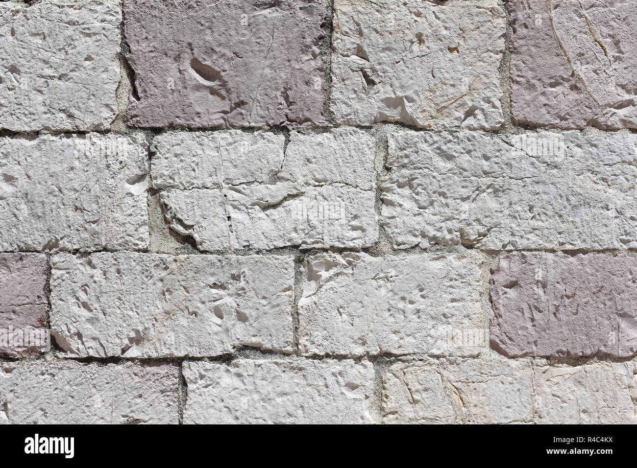 Stonework made from white-pink limestone - Stock Image