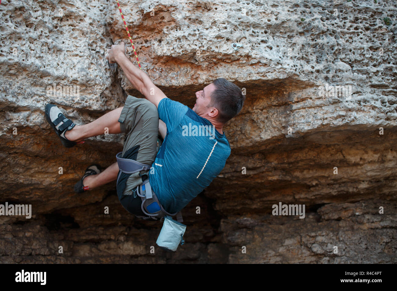 Photo from back of rock climber - Stock Image