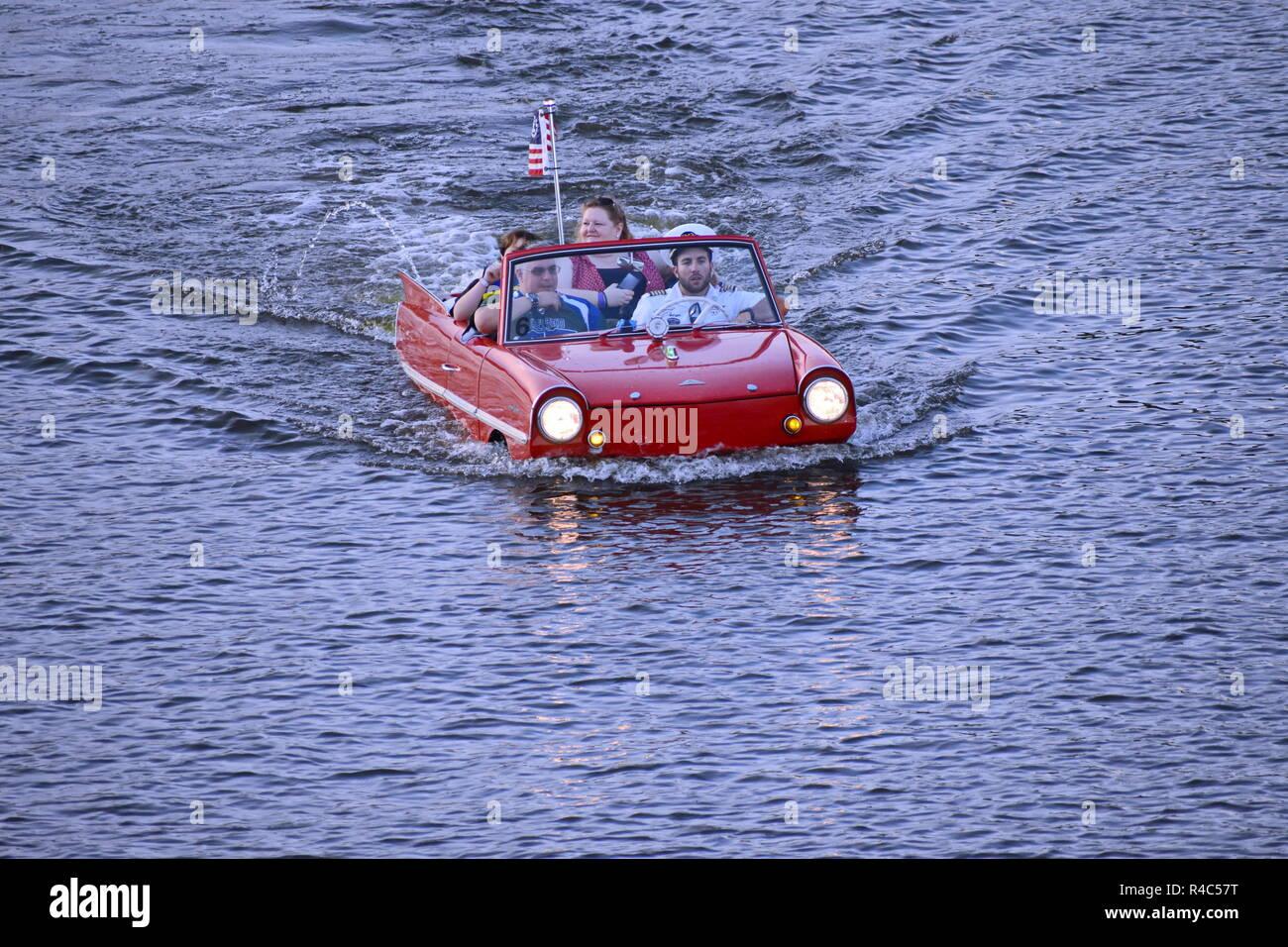 Orlando, Florida.  November 25, 2018 Nice family having fun red Amphicar ride over the blue lake  at Lake Buena Vista area - Stock Image