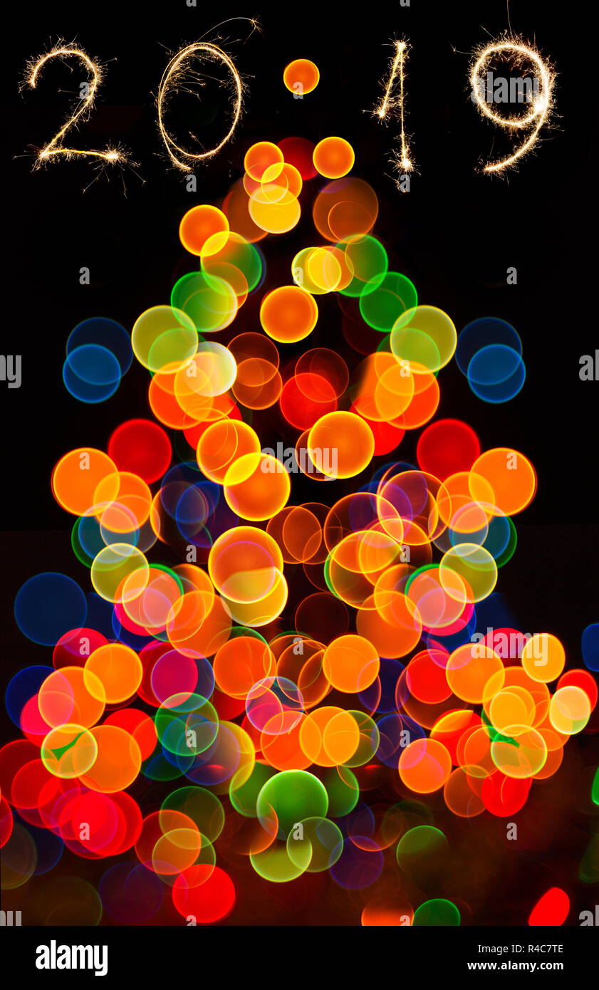 Abstract circular bokeh background of Christma tree slight, happy new year 2019 - Stock Image