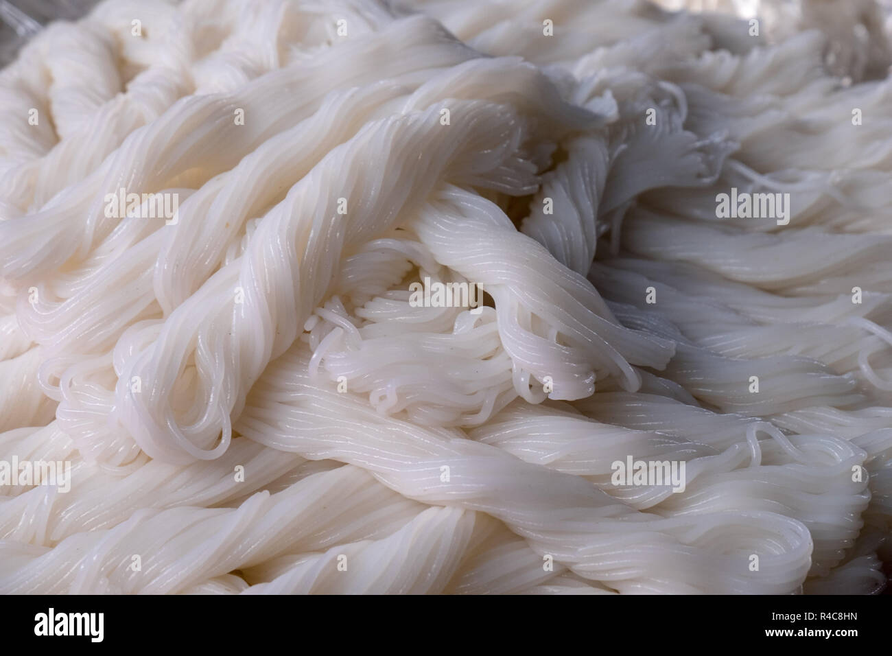 Cooked rice noodles on display at a stall in Dong Ba Market in Hue, Vietnam - Stock Image