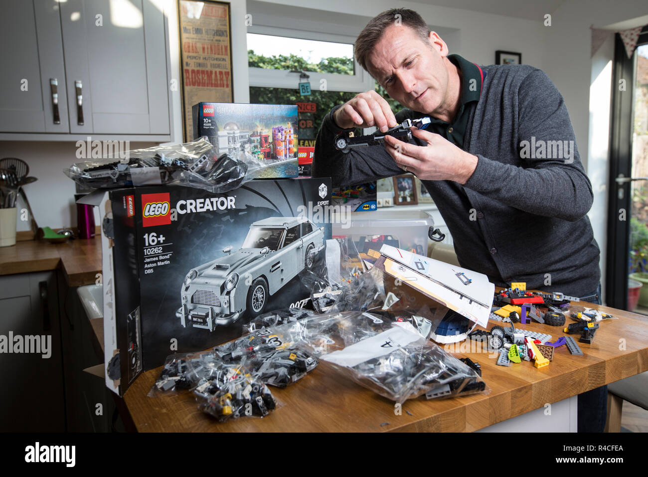 Middle aged man building Lego at home in England, as grown ups are admitting to addiction to the brick-building phenomenon, United Kingdom. - Stock Image