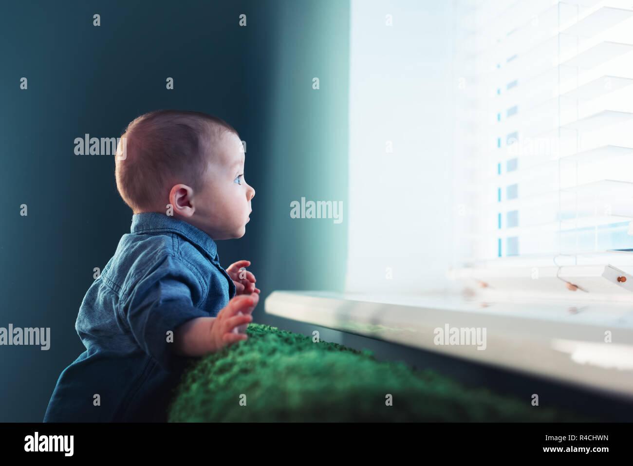 Newborn baby boy portrait on green carpet closeup. Motherhood and new life concept Stock Photo