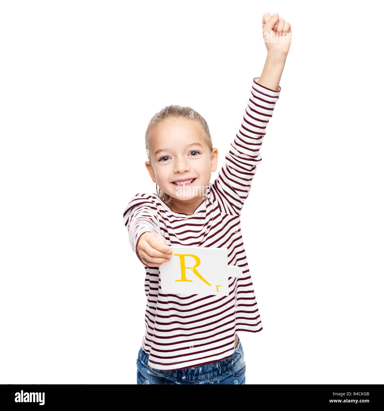 Cute young girl celebrating achievement at speech therapy. Child speech therapy concept isolated on white background. Hand in the air victory gesture. - Stock Image