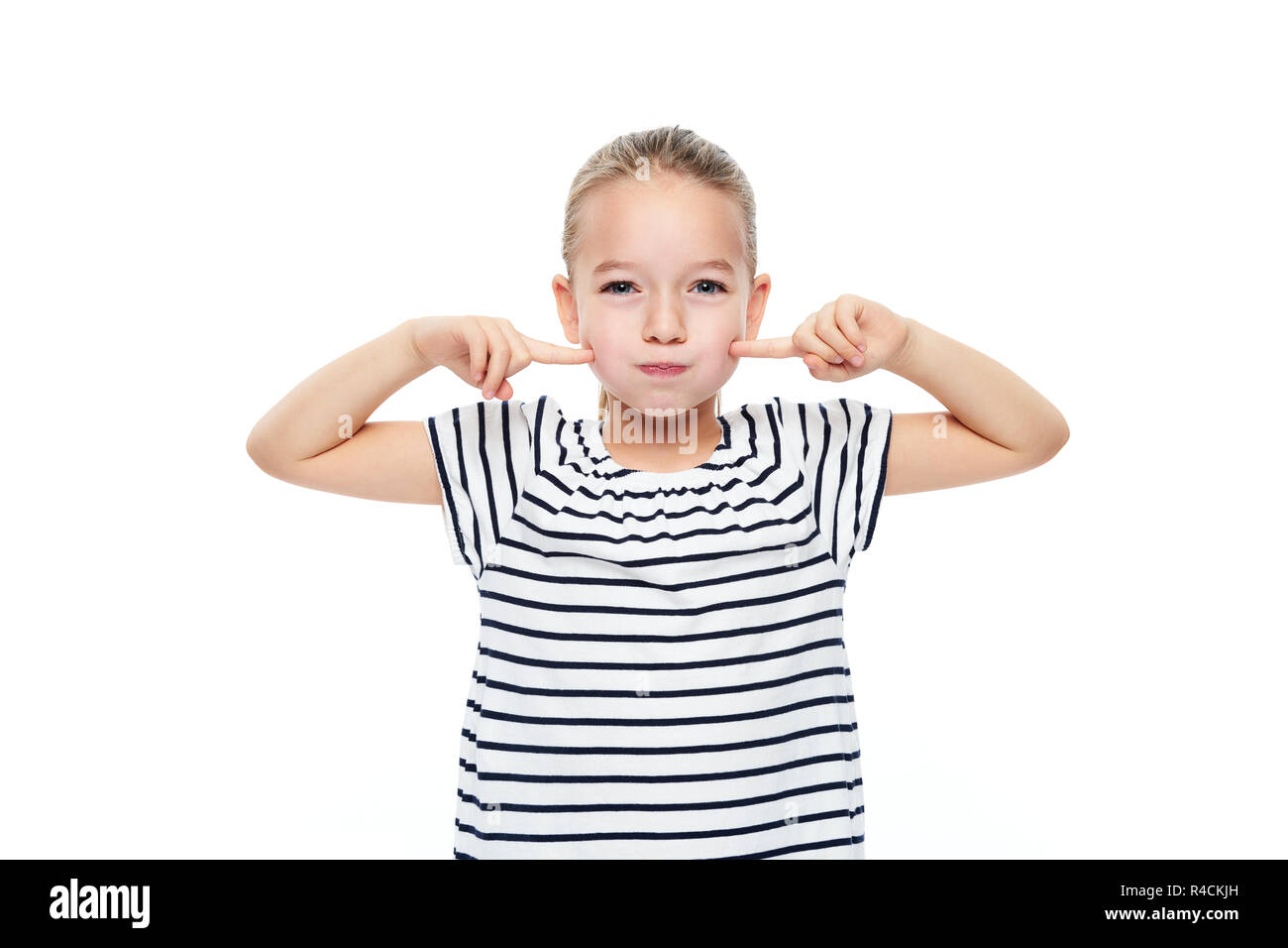 Cute young girl making special exercises at speech therapy office. Child speech therapy concept on white background. Speech impediment corrective exer - Stock Image