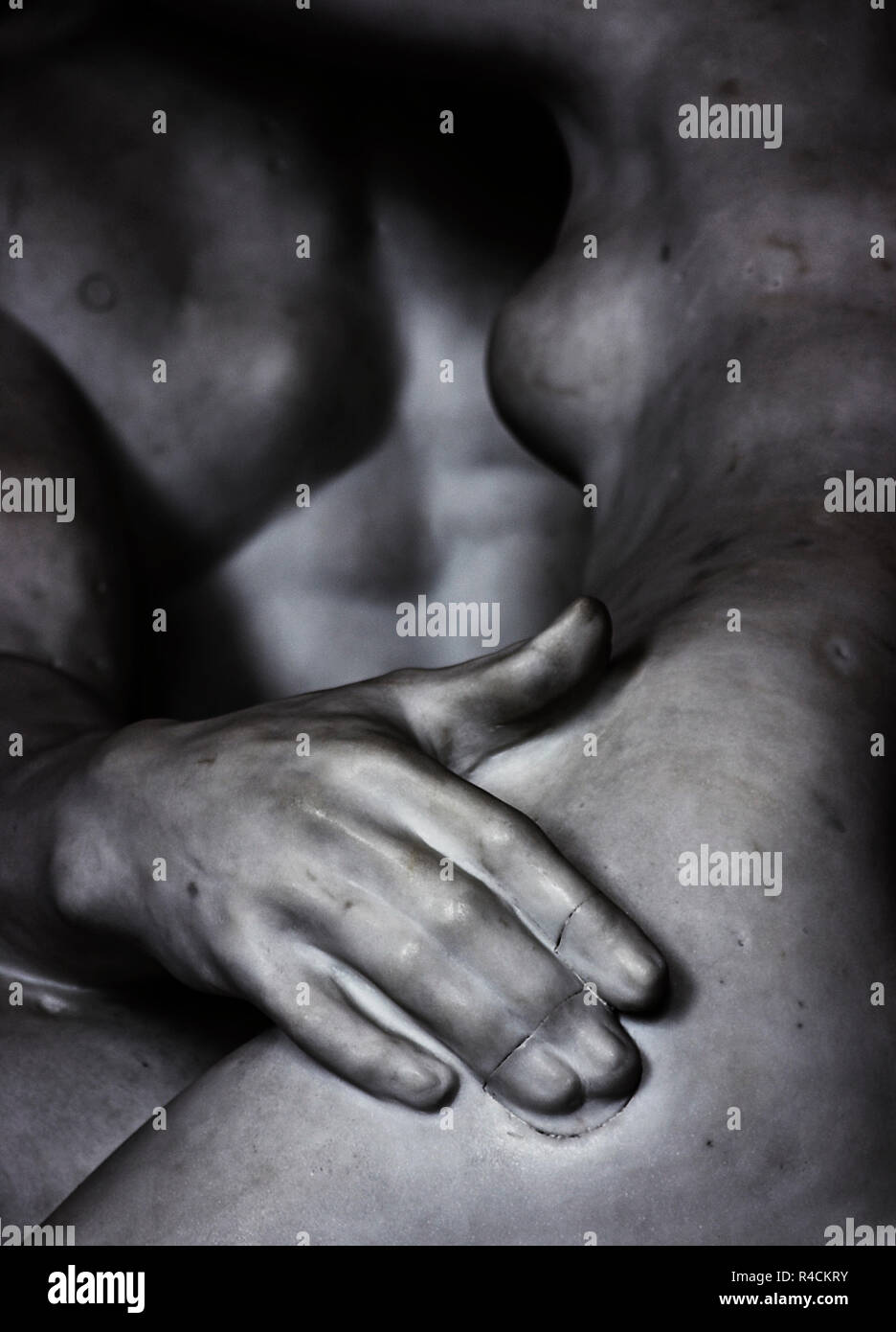 black and white detail of hand in Rodins sculpture Kiss - Stock Image