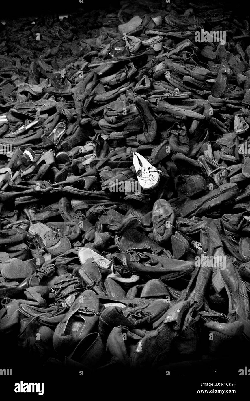 shoes from people who were killed at concentration camp Auschwitz Birkenau KZ Poland black and white image - Stock Image