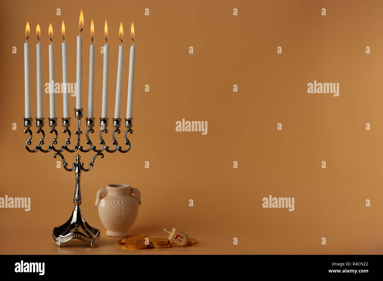 Composed lit menorah for Hanukkah celebration - Stock Image
