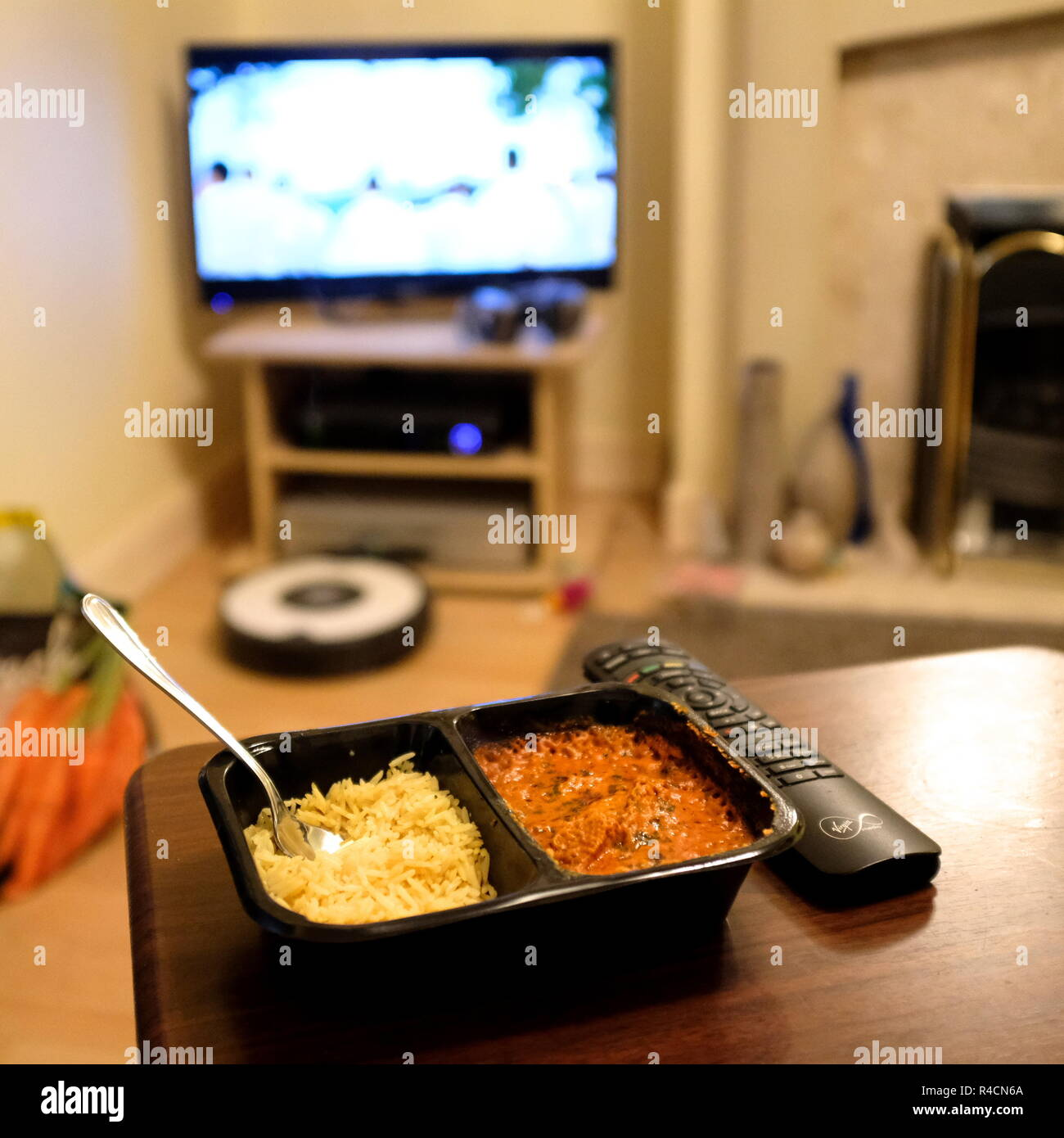 chicken tikka masala ready meal infront of tv - Stock Image