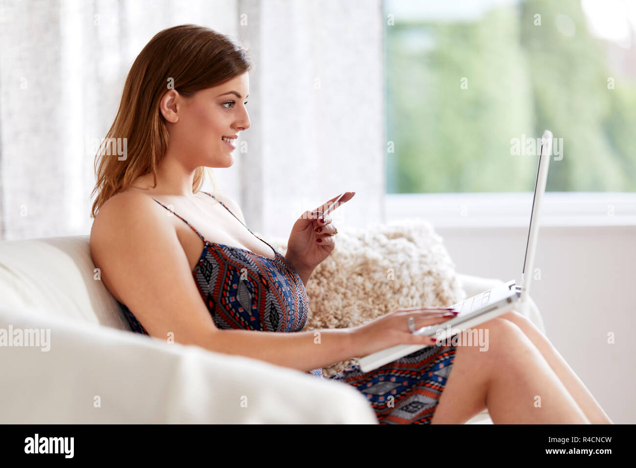 Woman shopping online - Stock Image