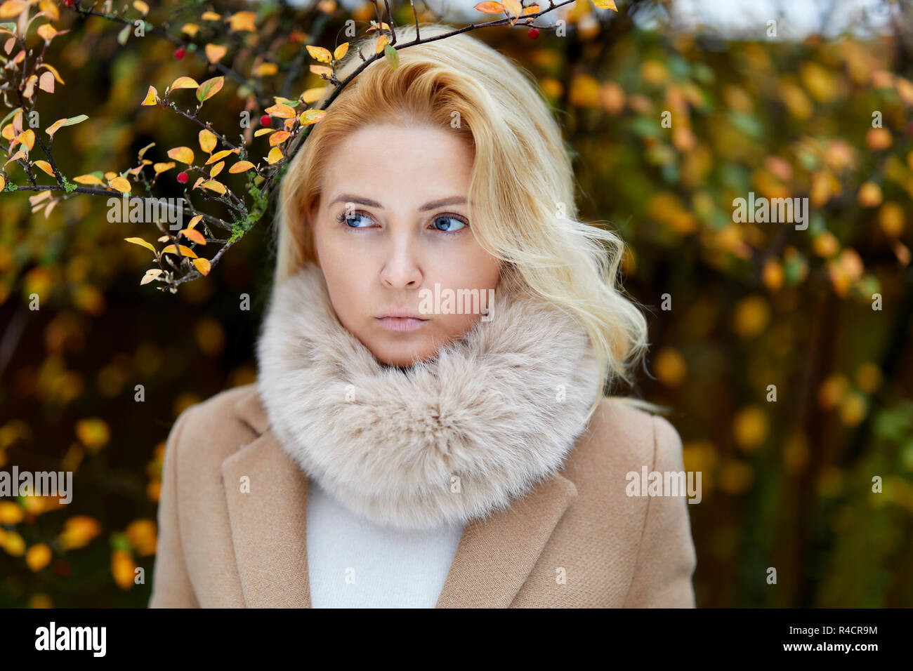 Woman walking outdoors thinking Stock Photo