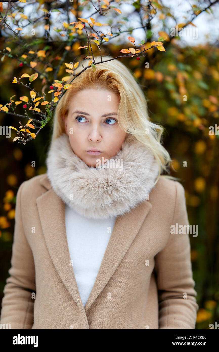 Woman walking outdoors thinking - Stock Image