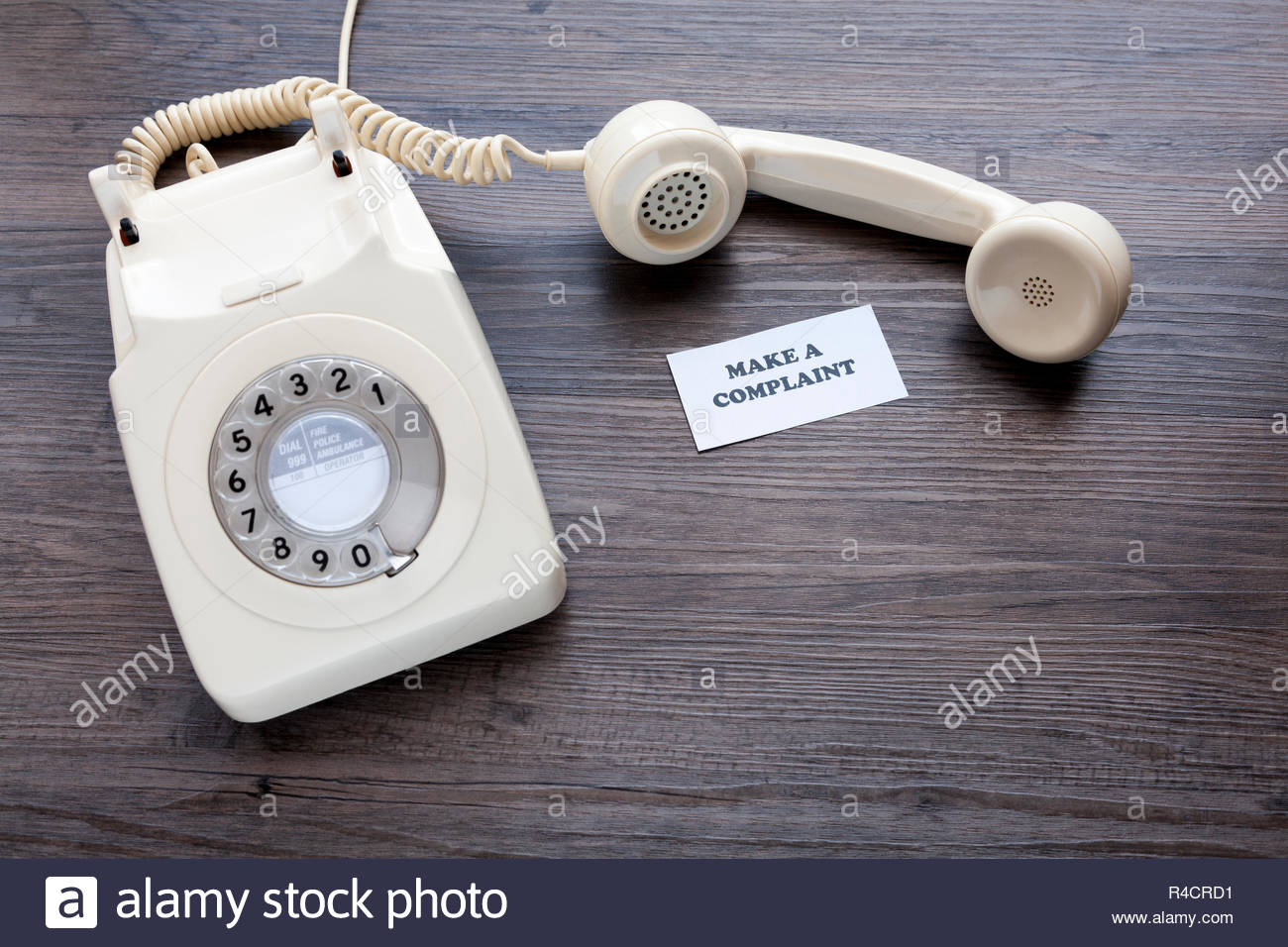 Retro telephone with note - Make A Complaint - Stock Image