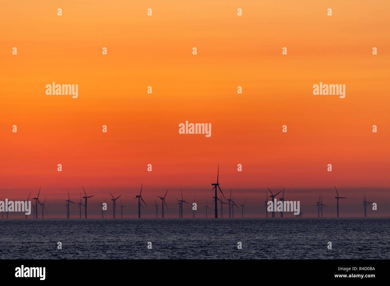 Offshore wind turbines at dawn at Colwyn Bay on the North Wales coast Stock Photo