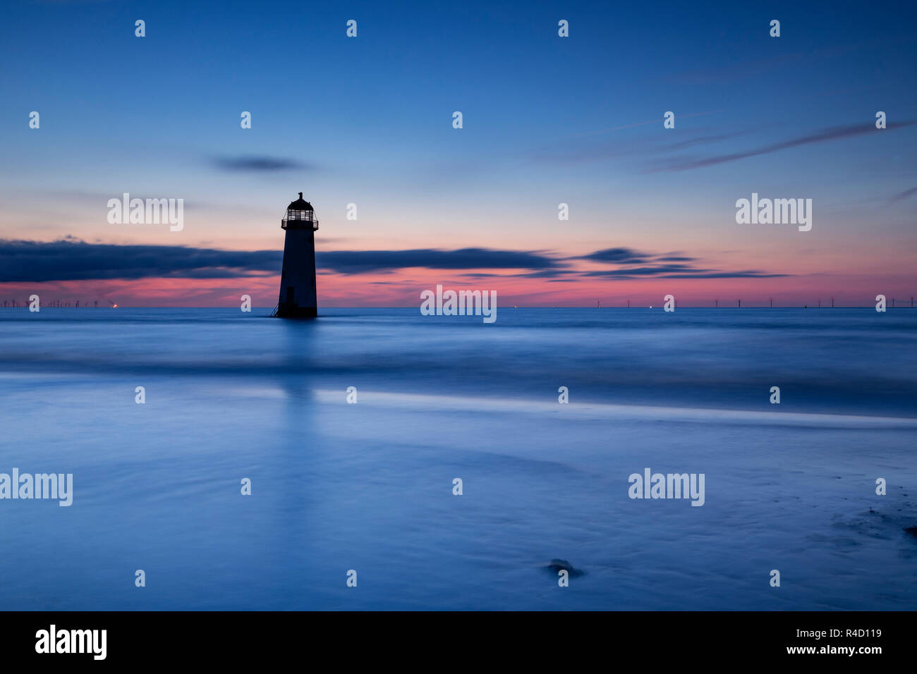 Point of Ayr lighthouse at dusk on Talacre beach, North Wales coast Stock Photo