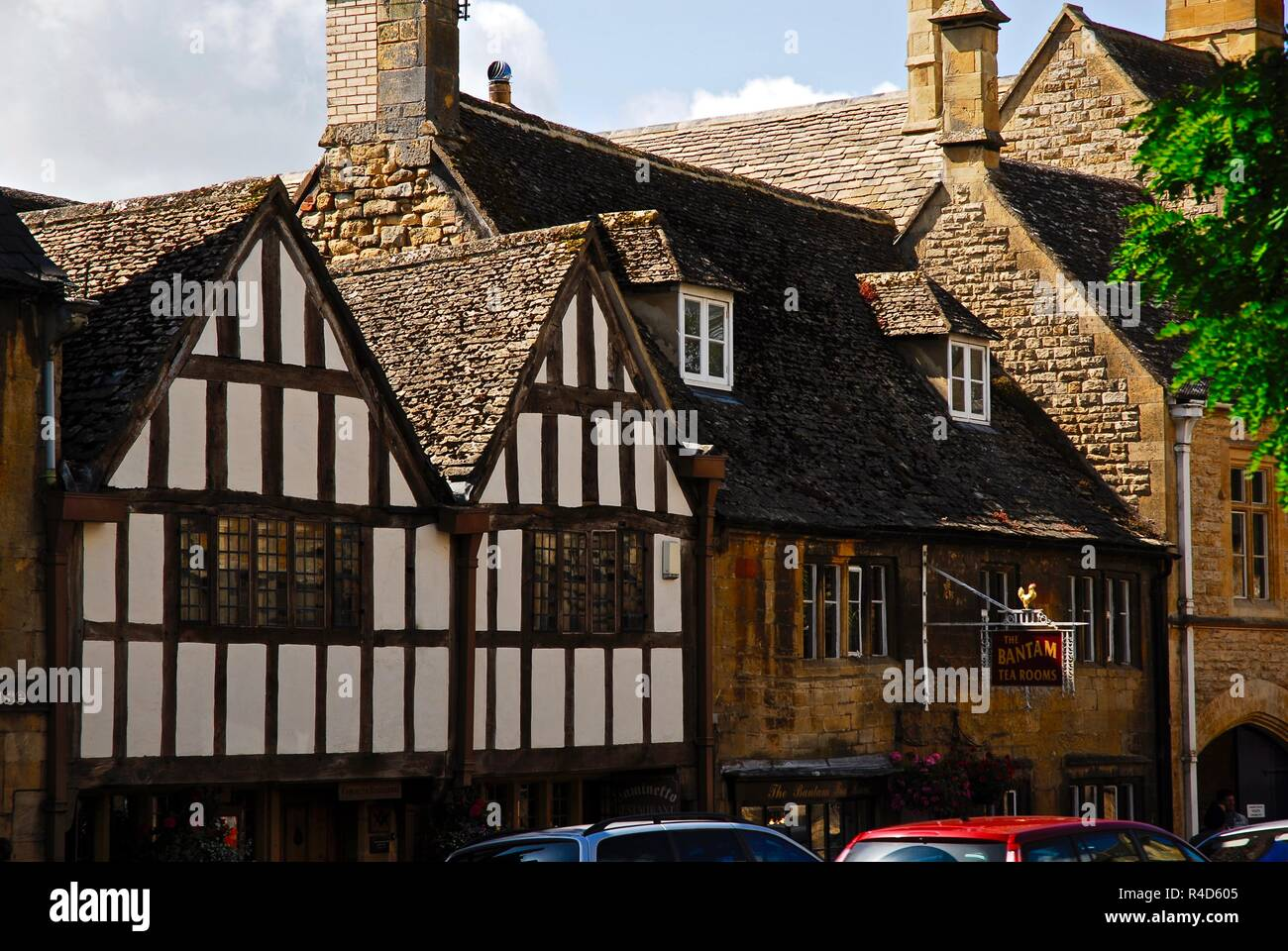 Half timbered, post and beam, tudor Cotswold stone buildings in the market town of Chipping Campden, Cotswolds, Gloucestershire, UK - Stock Image