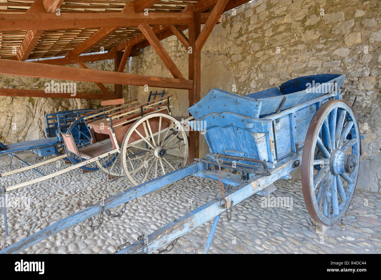 Vintage Old Horse-Drawn Carts c19th including a Fourragère or Hay Cart, a Jardiniere or Garden Cart & Tombereau on Display Citadel Sisteron - Stock Image