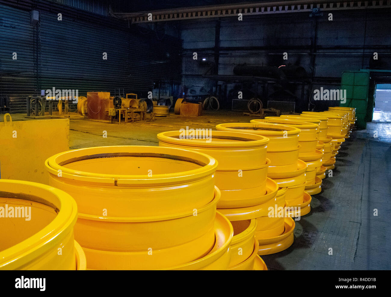 Disc rim production site for BelAZ dump trucks in the forge factory. Machine shop of metallurgical works indoors room. - Stock Image