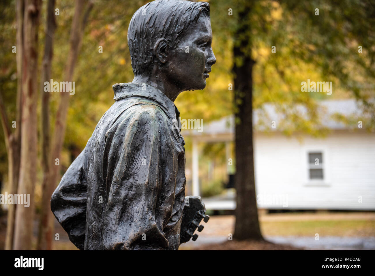 Bronze sculpture of 13 year old Elvis Presley with guitar at his birthplace in Tupelo, Mississippi. (USA) - Stock Image