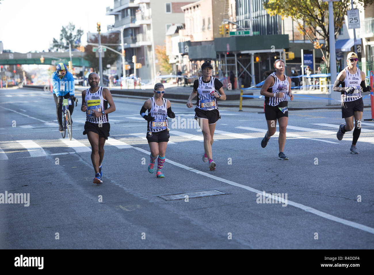 8e51cbb13 Runners cruise down 4th Avenue in Brooklyn during the first 3rd of the 2018 New  York City Marathon. These special runners each represent one of the five ...