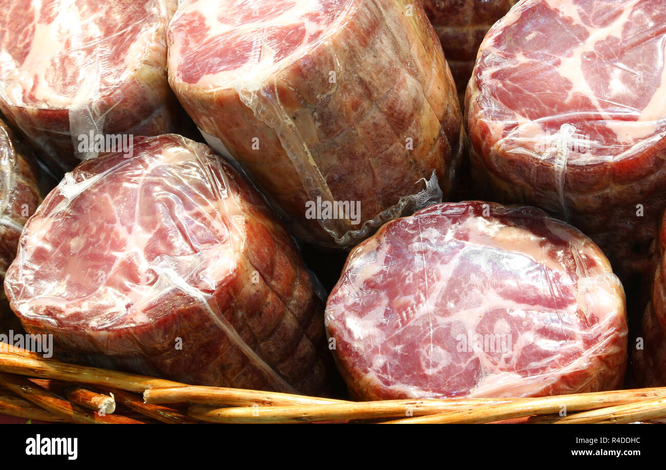 sausages packed with pvc film for sale in the delicatessen - Stock Image