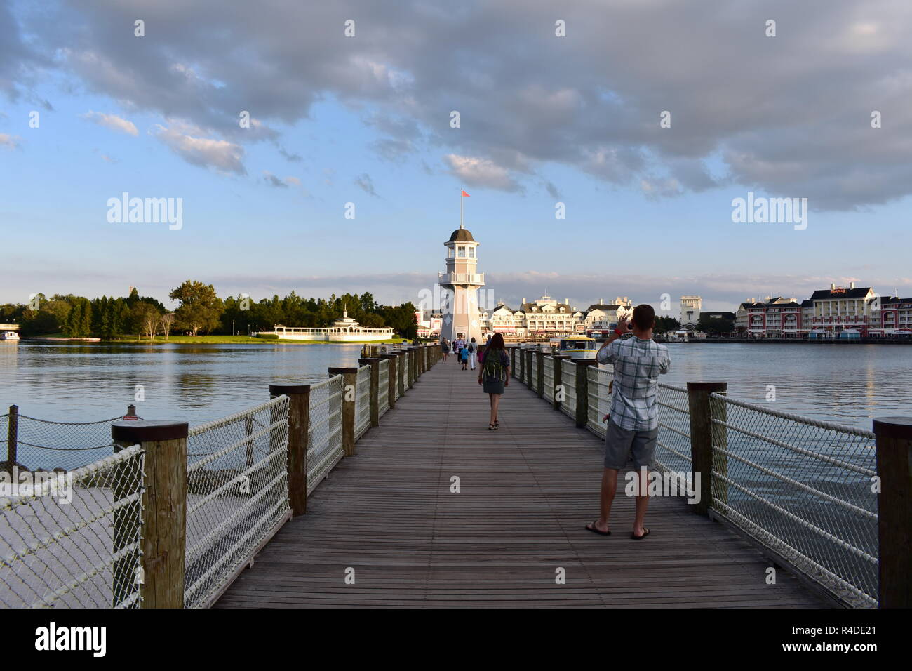Orlando, Florida. November 15, 2018 Man take a picture of lighthouse panoramic view and boardwalk at Lake Buena Vista area - Stock Image