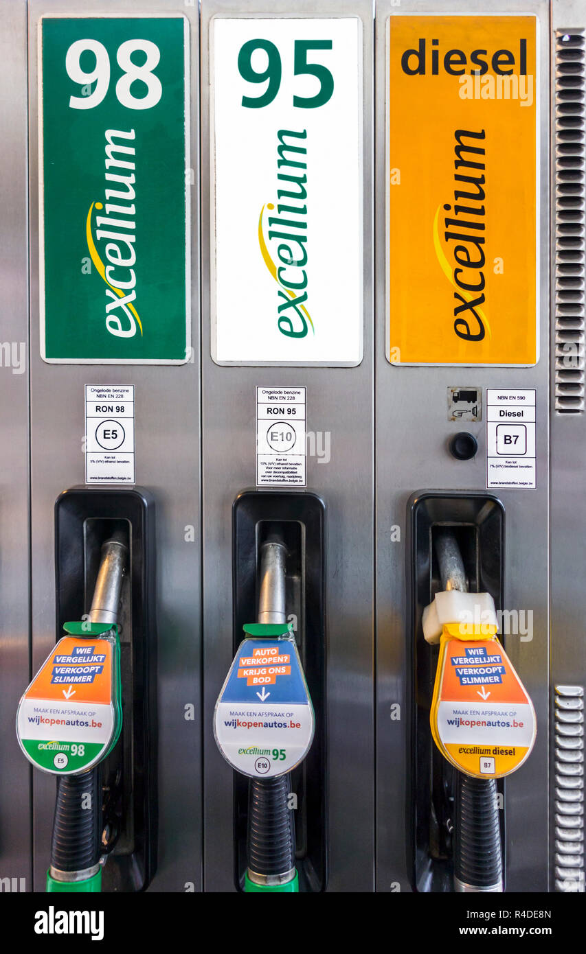 Color-coded gas pump nozzles and new EU fuel identification labels for gasoline E5 / E10 and diesel B7 at petrol station in Belgium, Europe - Stock Image