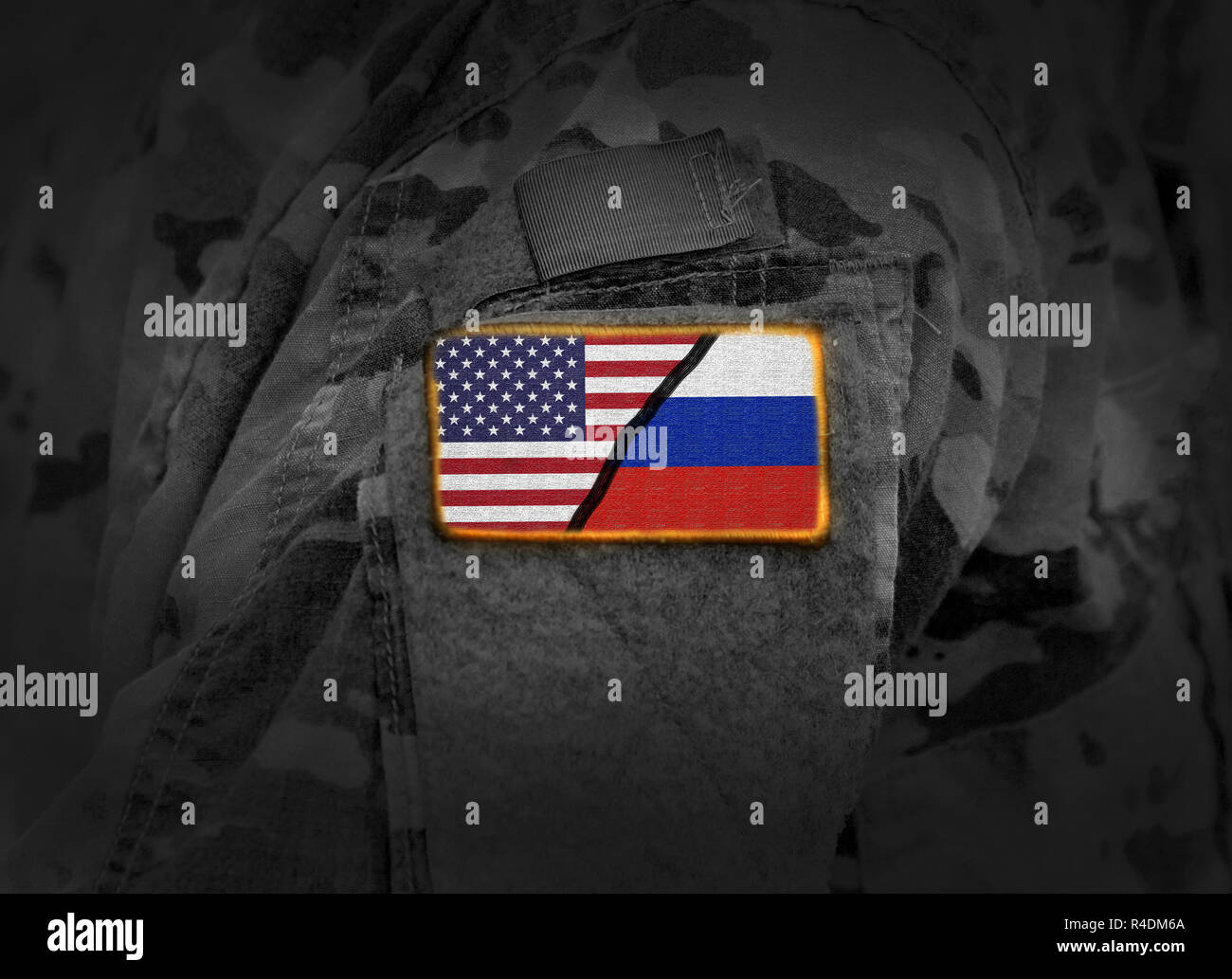 US vs Russia. Flag of United States and Russia at military uniform (collage) - Stock Image