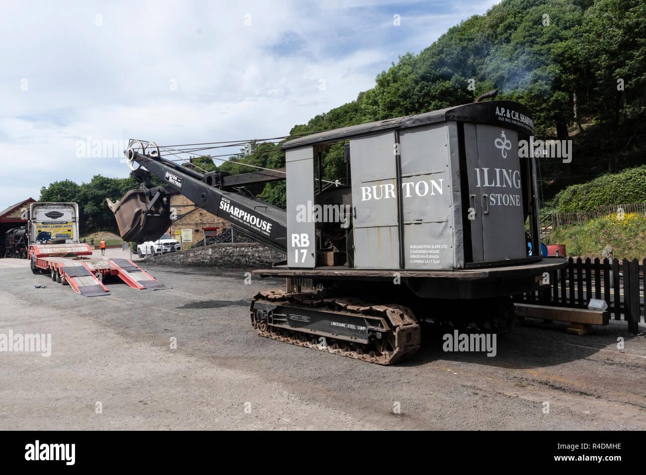 Ruston & Bucyrus caterpillar digger at Lakeside and Haverthwaite Steam Railway, Nr Ulverston, Cumbria, English Lake District, UK - Stock Image
