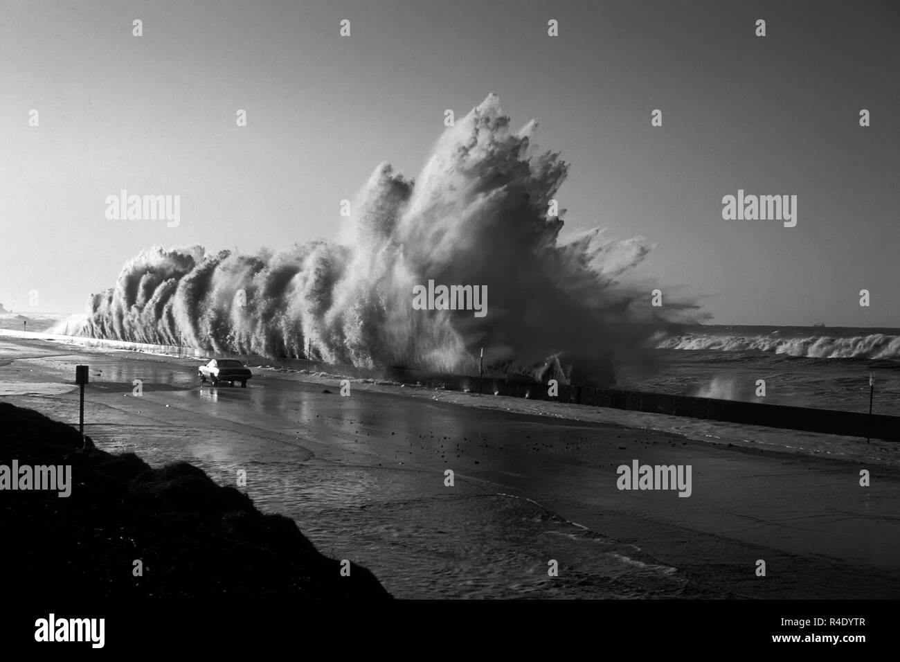 Huge storm surge wave crashes into a wall Solimar Beach.  Highway 1 California. - Stock Image