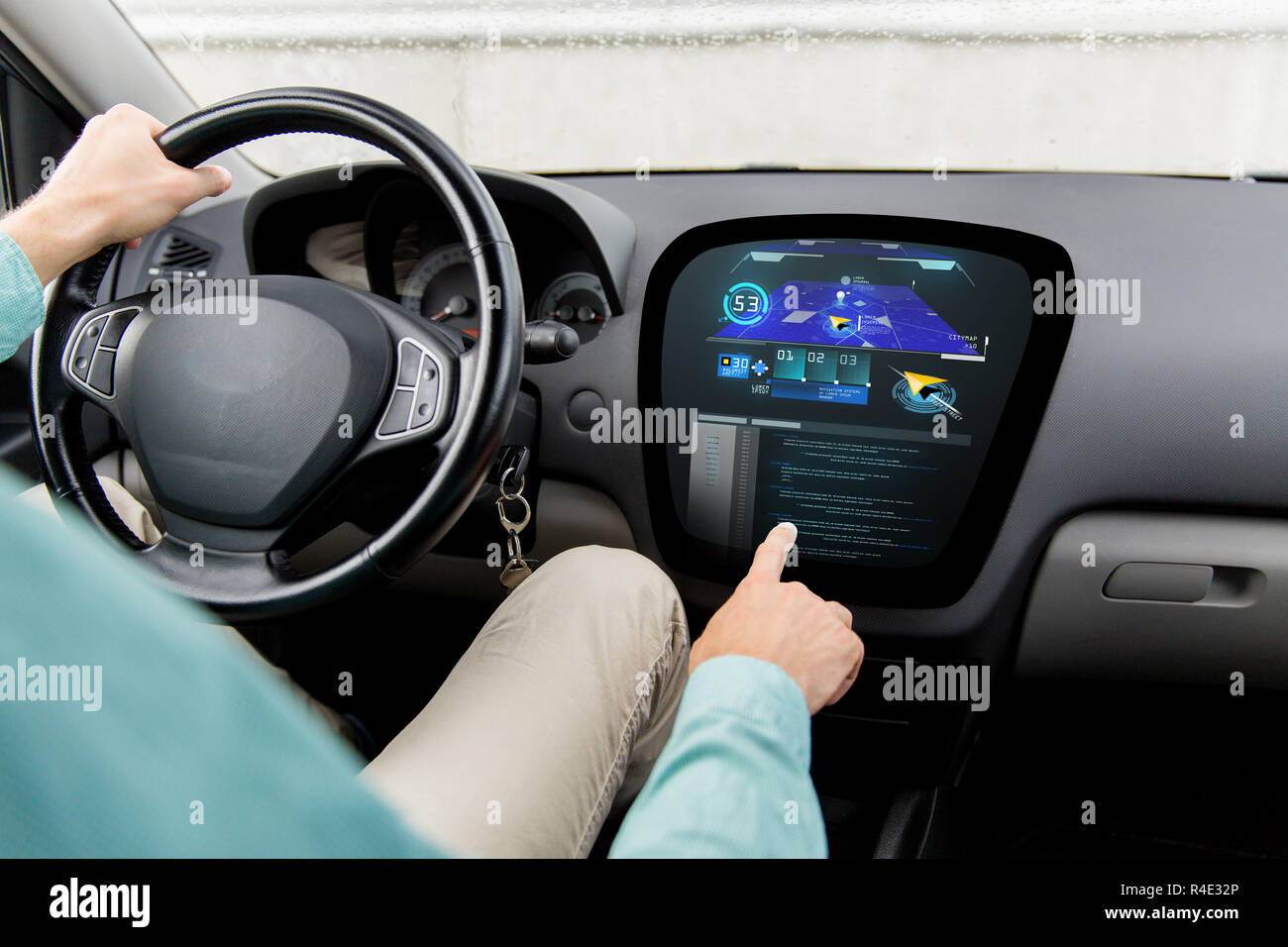 close up of man driving car with navigation system - Stock Image