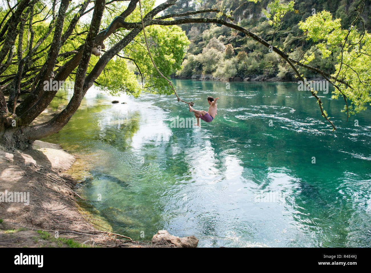 Jumping to the river, freedom - Stock Image