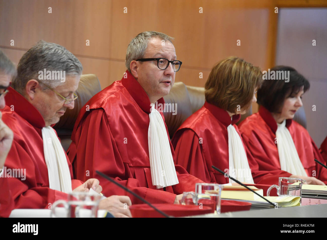 Karlsruhe, Germany. 27th Nov, 2018. The Second Senate at the Federal Constitutional Court, (l-r) Peter M. Huber, Chairman Andreas Voßkuhle, Monika Hermanns, Sibylle Kessal-Wulf, opens the oral proceedings in the matter of the 'European Banking Union'. This concerns central banking supervision in the euro area. Credit: Uli Deck/dpa/Alamy Live News - Stock Image