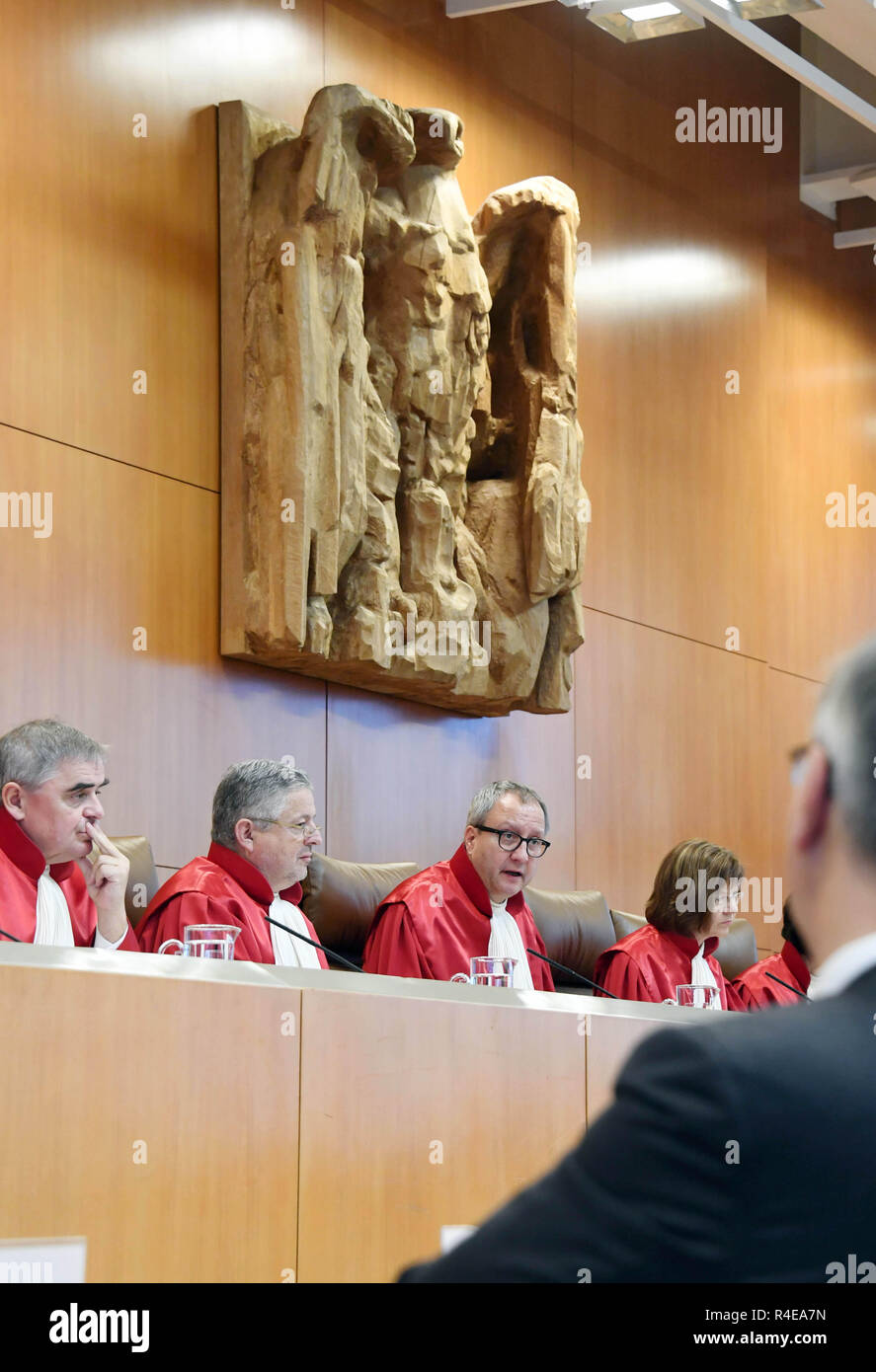 Karlsruhe, Germany. 27th Nov, 2018. The Second Senate of the Federal Constitutional Court, (l-r) Peter Müller, Peter M. Huber, Chairman Andreas Voßkuhle, Monika Hermanns, opens the oral hearing in the matter of the 'European Banking Union'. This concerns central banking supervision in the euro area. Credit: Uli Deck/dpa/Alamy Live News - Stock Image